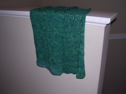 Green lace scarf seen from a distance.